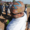 Shawn Relph the little brother of Legacy's coach Dawn Gaffin, came to the game with a painted head in celebration of the Lightning's 5th straight state 5A softball championship on Saturday at the Aurora Sports Park. <br /> October 22, 2011<br /> staff photo/ David R. Jennings