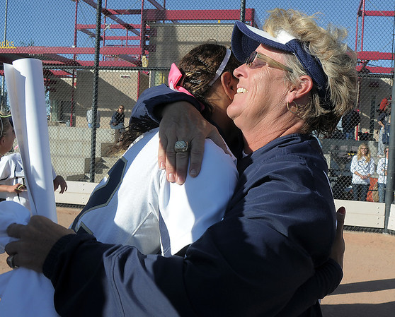 Legacy's coach Dawn Gaffin hugs her daughter, Rainey Gaffin , after winning the state 5A softball championship on Saturday at the Aurora Sports Park. This marks the 5th championship in a row for the LIghtning softball team.<br /> October 22, 2011<br /> staff photo/ David R. Jennings