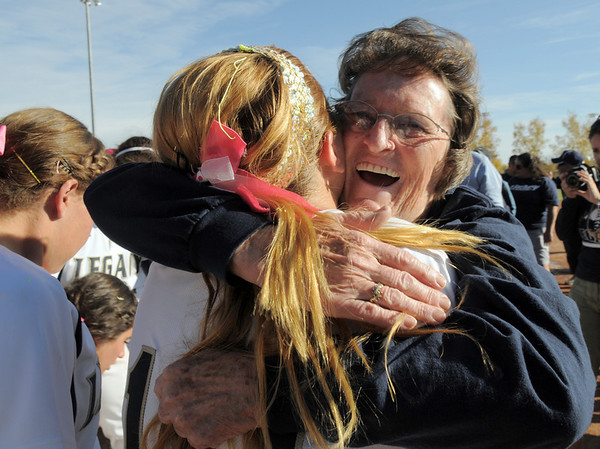 Grandma Rita Relph, mother of Legacy coach Dawn Gaffin, hugs Kara Walling while celebrating the Lightning's 5th straight state 5A softball championship on Saturday at the Aurora Sports Park. <br /> October 22, 2011<br /> staff photo/ David R. Jennings