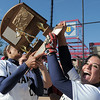 Legacy's Rainey Gaffin, left, and Jessica Ball show teammates the state 5A championship trophy after defeating Brighton 4-1 on Saturday at the Aurora Sports Park. This marks the 5th championship in a row for the LIghtning softball team.<br /> October 22, 2011<br /> staff photo/ David R. Jennings