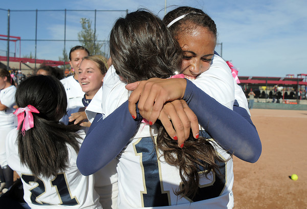 Legacy's Rainey Gaffin, left, hugs Jessica Ball after winning the state 5A championship defeating Brighton 4-1 on Saturday at the Aurora Sports Park. This marks the 5th state softball championship in a row for the Lightning.<br /> October 22, 2011<br /> staff photo/ David R. Jennings