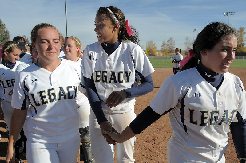 Legacy team holds hands lead by Jessica Ball, right, to greet Brighton after the state 5A softball championship on Saturday at the Aurora Sports Park. <br /> October 22, 2011<br /> staff photo/ David R. Jennings