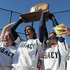 Legacy's Kelsey Dempsey, left, Rainey Gaffin, Jessica Ball and Kelsie Richardson hoist the state 5A championship trophy and game ball into the air after defeating Brighton 4-1 on Saturday at the Aurora Sports Park. This marks the 5th championship in a row for the LIghtning softball team.<br /> October 22, 2011<br /> staff photo/ David R. Jennings