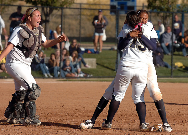Legacy's Rainey Gaffin celebrates with Jessica Ball and Kelsey Dempsey after defeating Brighton in the state 5A softball championship on Saturday at the Aurora Sports Park. <br /> October 22, 2011<br /> staff photo/ David R. Jennings