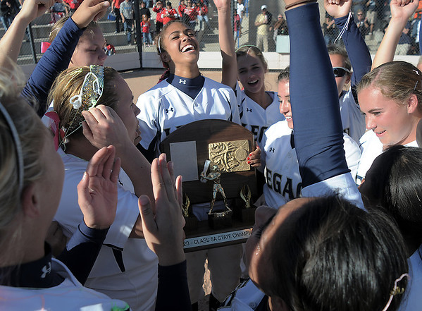 Legacy's Rainey Gaffin, center, celebrates with the team after defeating Brighton 4-1 in the state 5A softball championship on Saturday at the Aurora Sports Park. <br /> October 22, 2011<br /> staff photo/ David R. Jennings