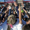The Lightning holds their hands up in celebration of defeating the Bulldogs 4-1 in the state 5A softball championship on Saturday at the Aurora Sports Park. <br /> October 22, 2011<br /> staff photo/ David R. Jennings