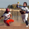 Legacy's Jessica Ball throws to firstbase after getting Brighton's Joslynn Lopez out for a double in the final play of the the state 5A softball championship game on Saturday at the Aurora Sports Park. <br /> October 22, 2011<br /> staff photo/ David R. Jennings
