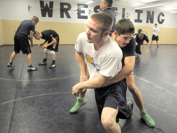 Legacy's Jesse Carlson, left, and Brian Mooney work on wrestling techniques during practice at the school on Friday.<br /> For more photos see broomfieldenterprise.com<br /> November 25, 2011<br /> staff photo/ David R. Jennings