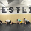Legacy's  wrestling team line up against a wall for a warm-up exercise  during practice at the school on Friday.<br /> For more photos see broomfieldenterprise.com<br /> November 25, 2011<br /> staff photo/ David R. Jennings