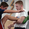 Legacy's Jesse Carlson, right, and Brian Mooney work on wrestling techniques during practice at the school on Friday.<br /> For more photos see broomfieldenterprise.com<br /> November 25, 2011<br /> staff photo/ David R. Jennings