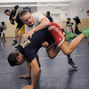 Legacy's Jesse Carlson, top, and Brian Mooney work on wrestling techniques during practice at the school on Friday.<br /> For more photos see broomfieldenterprise.com<br /> November 25, 2011<br /> staff photo/ David R. Jennings