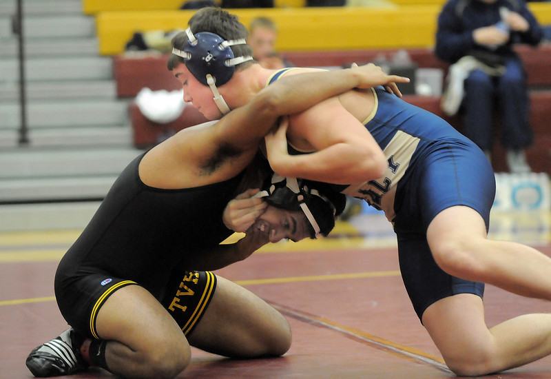 Legacy's Connor Cassidy wrestles Thompson Valley's Savdeep Athwal in the 170lb. weight class during the Windsor wrestling invitational tournament at Windsor High School on Saturday.<br /> For more photos please see broomfieldenterprise.com.<br /> December 3, 2011<br /> staff photo/ David R. Jennings