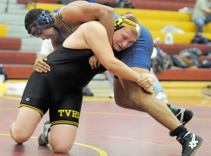 Legacy's Skylar McWee wrestles Thompson Valley's Lee Chippo in the 220lb. weight class during the Windsor wrestling invitational tournament at Windsor High School on Saturday.<br /> For more photos please see broomfieldenterprise.com.<br /> December 3, 2011<br /> staff photo/ David R. Jennings