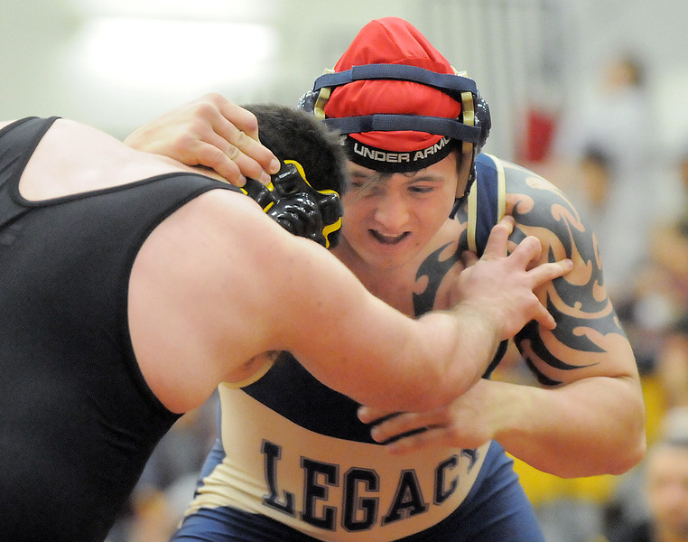 Legacy's Austin Yurko wrestles Thompson Valley's Jacob Vefonda in the 285lb. weight class during the Windsor wrestling invitational tournament at Windsor High School on Saturday.<br /> For more photos please see broomfieldenterprise.com.<br /> December 3, 2011<br /> staff photo/ David R. Jennings