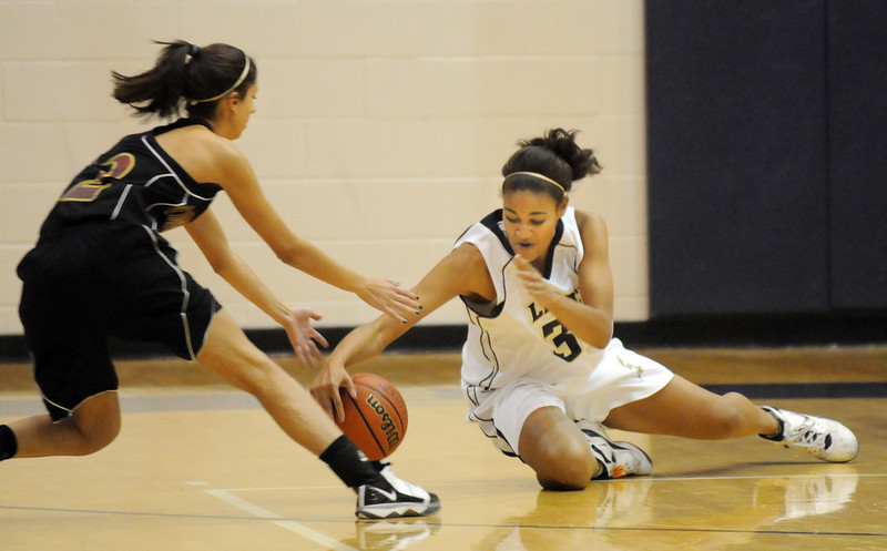 Legacy's Sade Akindele, right, scrambles for a loose ball with Maggie Kroskob, Ponderosa during Tuesday's game at Legacy.<br /> December 8, 2009<br /> Staff photo/David R. Jennings