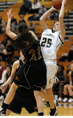 Legacy's Sarah Dunahay, right, shoots the ball past Hannah Paust during Tuesday's game at Legacy.<br /> December 8, 2009<br /> Staff photo/David R. Jennings