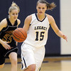 Legacy's Carli Moreland drives down court past Ponderosa's Sam Scheiber during the game on Tuesday at Legacy.<br /> December 8, 2009<br /> Staff photo/David R. Jennings