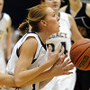 Legacy's Sarah Leister has the ball knocked out of her hands by  Pondersoa's Hannah Paust during Tuesday's game at Legacy.<br /> December 8, 2009<br /> Staff photo/David R. Jennings