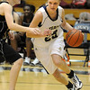 Legacy's Sara Dunahay, right, drives past Sam Scheiber, Ponderosa, during Tuesday's game at Legacy.<br /> December 8, 2009<br /> Staff photo/David R. Jennings