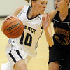 Legacy's Sarah Leister, left, drive to the basket past Pondersoa's Madison Amundsen during Tuesday's game at Legacy.<br /> December 8, 2009<br /> Staff photo/David R. Jennings