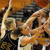 Legacy's Carli Moreland, right, goes for a loose ball past Sam Scheiber, Ponderosa during Tuesday's game at Legacy.<br /> December 8, 2009<br /> Staff photo/David R. Jennings