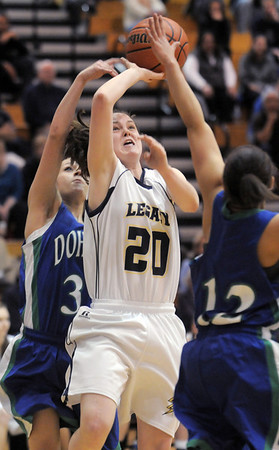 Legacy's Jordan Eisler goes to the basket against Makala Woods and Laurin Rivera, Doherty during Tuesday's state 5A playoff game at Legacy.<br /> <br /> March 1, 2011<br /> staff photo/David R. Jennings