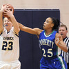 Legacy's Caitlin Smith grabs the ball from Aiesha Harris, Doherty during Tuesday's state 5A playoff game at Legacy.<br /> <br /> March 1, 2011<br /> staff photo/David R. Jennings