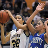 Legacy's Kailey Edwards goes to the basket against Shalisa Moffit, Doherty during Tuesday's state 5A playoff game at Legacy.<br /> <br /> March 1, 2011<br /> staff photo/David R. Jennings