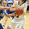 Legacy's Jordan Eisler, has the ball knocked away by Makala Woods,  Doherty during Tuesday's state 5A playoff game at Legacy.<br /> <br /> March 1, 2011<br /> staff photo/David R. Jennings