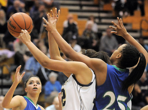 Legacy's Sade Akindele collides with Aiesha Harris, Doherty during Tuesday's state 5A playoff game at Legacy.<br /> <br /> March 1, 2011<br /> staff photo/David R. Jennings