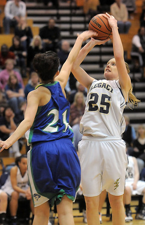 Legacy's Sarah Dunahay shoots the ball over Danielle Santos, Doherty during Tuesday's state 5A playoff game at Legacy.<br /> <br /> March 1, 2011<br /> staff photo/David R. Jennings
