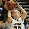 Legacy's Jordan Eisler goes to the basket against Doherty during Tuesday's state 5A playoff game at Legacy.<br /> <br /> March 1, 2011<br /> staff photo/David R. Jennings