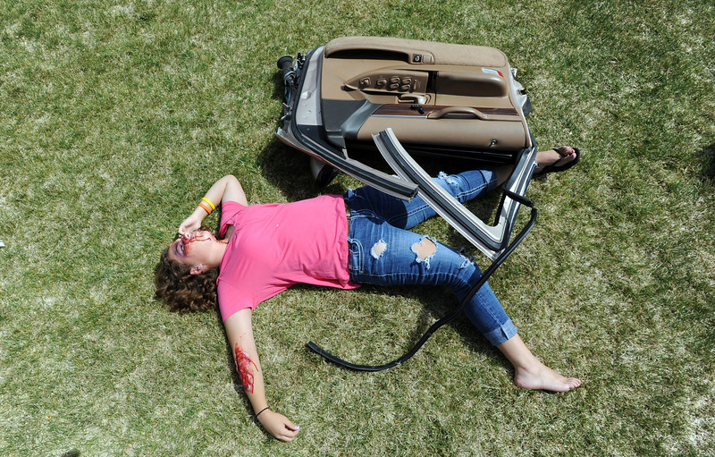 Student volunteer Kelsie Richardson tries to make herself look like she was thrown from a vehicle during the pre-prom drunk driving accident demonstration at Legacy High School on Thursday.<br /> <br /> April 26, 2012 <br /> staff photo/ David R. Jennings