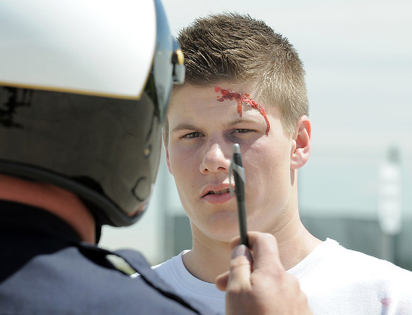 """Student volunteer actor Joe Konopka, left, """"tries"""" to take a roadside  sobriety test given by Broomfield Police traffic officer Paul Lesh during the pre-prom drunk driving accident demonstration at Legacy High School on Thursday.<br /> <br /> <br /> April 26, 2012 <br /> staff photo/ David R. Jennings"""