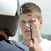 "Student volunteer actor Joe Konopka, left, ""tries"" to take a roadside  sobriety test given by Broomfield Police traffic officer Paul Lesh during the pre-prom drunk driving accident demonstration at Legacy High School on Thursday.<br /> <br /> <br /> April 26, 2012 <br /> staff photo/ David R. Jennings"