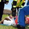 "Student volunteer Kelsie Richardson is ""treated""  during the pre-prom drunk driving mock accident demonstration at Legacy High School on Thursday.<br /> <br /> April 26, 2012 <br /> staff photo/ David R. Jennings"