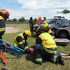 "Firefighters with North Metro Fire Rescue District  ""treat"" Kelsie Richardson at the scene of a mock drunken driver accident while an Air Life helicopter lands during the demonstration at Legacy High School on Thursday.<br /> <br /> April 26, 2012 <br /> staff photo/ David R. Jennings"