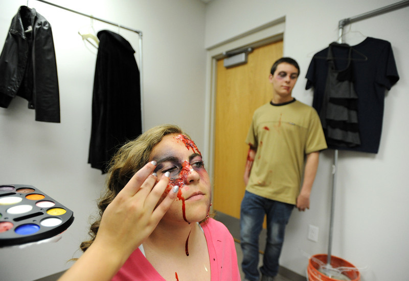 "Kelsie Richardson has her accident ""victim"" make up on by Amanda Chrock, with fellow ""victim"" Sam Thomas for the pre-prom mock drunk driving accident demonstration at Legacy High School on Thursday.<br /> <br /> April 26, 2012 <br /> staff photo/ David R. Jennings"