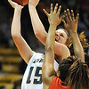 Legacy's Carli Moreland fights to the basket against Denver East's Tasha Carey during the class 5A championship game at the Coors Events Center in Boulder on Friday.<br /> <br /> <br /> March 10, 2010<br /> Staff photo/David R. Jennings