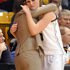 Legacy's Carli Moreland hugs head coach Jamie Carey after fouling out and loosing to Denver East 46 to 50 in the class 5A championship game at the Coors Events Center in Boulder on Friday.<br /> <br /> <br /> March 10, 2010<br /> Staff photo/David R. Jennings