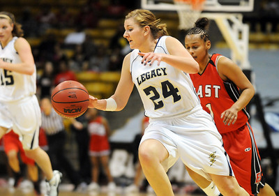 Legacy's Quincey Noonan drives down court after stealing the ball from Denver East during the class 5A championship game at the Coors Events Center in Boulder on Friday.   March 10, 2010 Staff photo/David R. Jennings