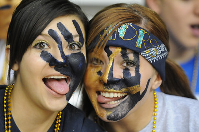 Legacy fans Alexis Brungardt, left, and Ariel McGee painted their faces for the class 5A championship game against Denver East  at Coors Events Center in Boulder on Friday.   March 12, 2010 Staff photo/David R. Jennings