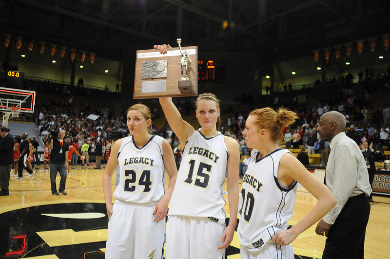 Legacy's Quincey Noonan, Carli Moreland and Sarah Leister hold up the second place trophy for the class 5A championship game at the Coors Events Center in Boulder on Friday.<br /> <br /> <br /> March 10, 2010<br /> Staff photo/David R. Jennings