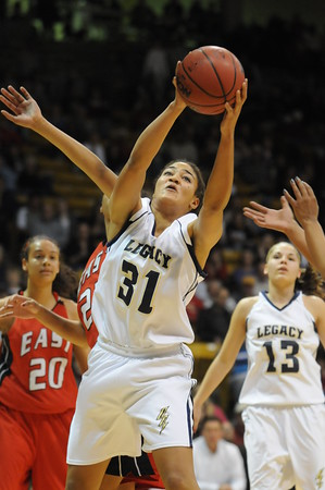 Legacy's Sade Akindele rebounds the ball against Denver East during the class 5A championship game at the Coors Events Center in Boulder on Friday.<br /> <br /> <br /> March 10, 2010<br /> Staff photo/David R. Jennings