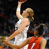 Legacy's Quincey Noonan shoots  to the basket against Denver East's Samantha Sanders during the class 5A championship game at the Coors Events Center in Boulder on Friday.<br /> <br /> <br /> March 10, 2010<br /> Staff photo/David R. Jennings