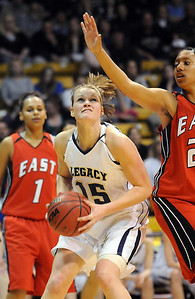 Legacy's Carli Moreland eyes the basket against Denver East's during the class 5A championship game at the Coors Events Center in Boulder on Friday.   March 10, 2010 Staff photo/David R. Jennings