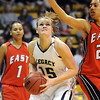 Legacy's Carli Moreland eyes the basket against Denver East's during the class 5A championship game at the Coors Events Center in Boulder on Friday.<br /> <br /> <br /> March 10, 2010<br /> Staff photo/David R. Jennings