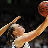 Legacy's Carli Moreland goes to the basket against Denver East during the class 5A championship game at the Coors Events Center in Boulder on Friday.<br /> <br /> <br /> March 10, 2010<br /> Staff photo/David R. Jennings