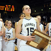 Carli Moreland, center, with the Legacy watch Denver Eastrecieve the championship trophy in the class 5A championship game at the Coors Events Center in Boulder on Friday.<br /> <br /> <br /> March 10, 2010<br /> Staff photo/David R. Jennings