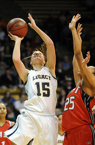 Legacy's Carli Moreland goes to the basket against Denver East's Deidra Smith during the class 5A championship game at the Coors Events Center in Boulder on Friday.   March 10, 2010 Staff photo/David R. Jennings